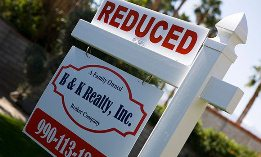 Real Estate Sign Advertising Reduced Price (©moodboard/Alamy, Pharaoh/Alamy)