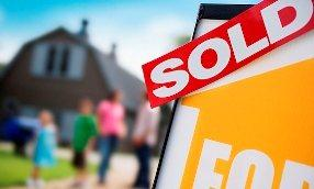 Sold sign; &#169; Simon Jarratt/Corbis
