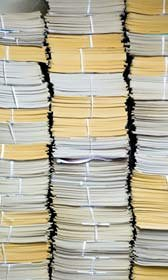 Stacks of papers (© Win Initiative/Getty Images)