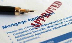 Approved mortgage application (© Alex Stojanov/Alamy)