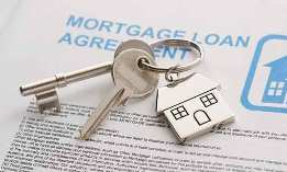 Keys to a new home on mortgage papers (&#169; SuperStock)