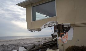 Home damaged during Hurricane Sandy in the Rockaways, Long Island, New York (©Robert Nickelsberg/Getty Images)