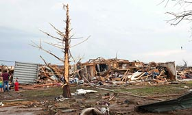 Stripped trees and destroyed houses following a tornado in Moore, Okla. (©Richard Rowe/Reuters)