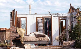 Home damaged by tornado in Moore, Okla. (©Rick Wilking/Reuters)