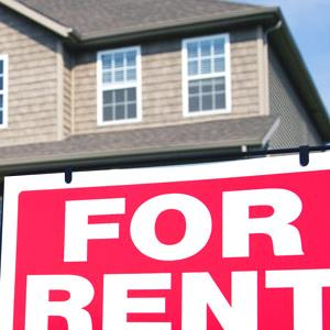Home with for rent sign (© VStock LLC/Tetra Images/Corbis)