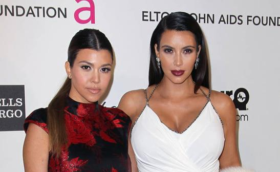 Kourtney and Kim Kardashian/WENN