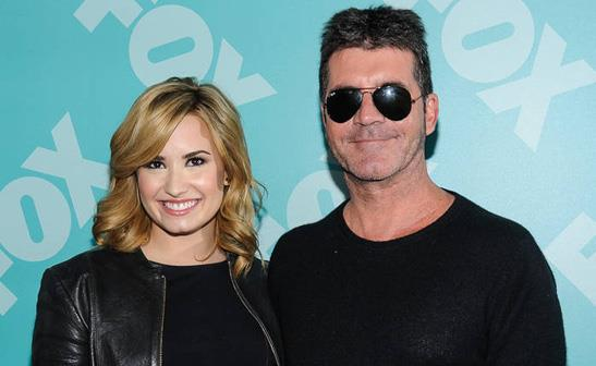 Demi Lovato and Simon Cowell/WENN