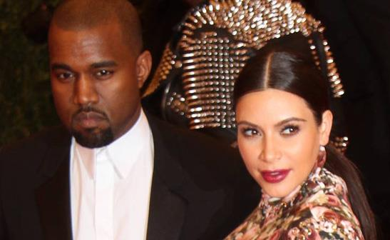 Kanye West and Kim Kardashian/WENN