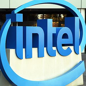 Caption: The Intel logo is displayed outside of the Intel headquarters in Santa Clara, Calif