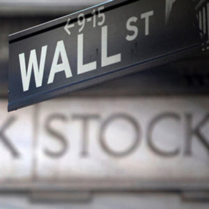 A Wall Street sign outside the New York Stock Exchange. (© Carlo Allegri/Reuters)