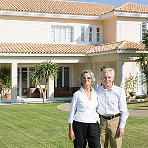 Couple stood outside of villa © Image Source, Getty Images