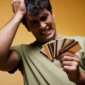 Distraught man with credit cards © Hill Street Studios, Getty Images