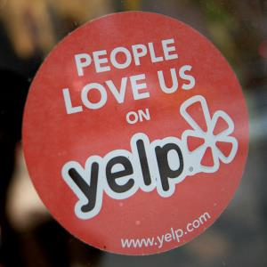 Yelp sticker on a New York restaurant window (c) Scott Eells via Bloomberg/Getty Images