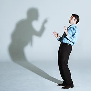 Businessman scared of his shadow © 237/Martin Barraud/Ocean/Corbis