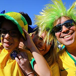 Fans of Brazil pose before the World Cup opening ceremony © Amin Mohammad Jamali/Getty Images