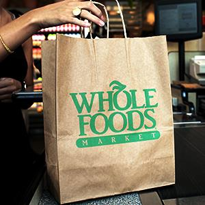 Caption: A customer checks out of a Whole Foods Market in Washington, D.C.Credit: © Andrew Councill/Bloomberg via Getty Images