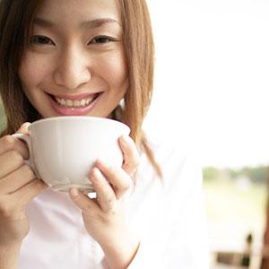 Image: Coffee Woman (© Bloomimage/Corbis)