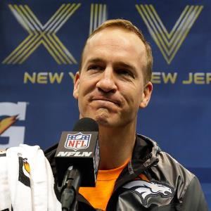 Denver Broncos' Peyton Manning answers questions during media day for the Super Bowl. © Matt Slocum/AP