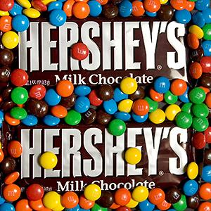 Hershey's Milk Chocolate bars are arranged underneath M&Ms, a Mars product © Jb Reed/Bloomberg via Getty Images