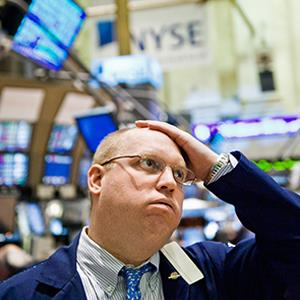 Credit: © xPACIFICA/CorbisCaption: A trader on the floor of the New York stock exchange