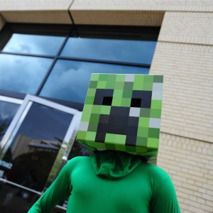 A man dressed as a Minecraft creeper (c) REX/Alex Milan Tracy/NurPhoto