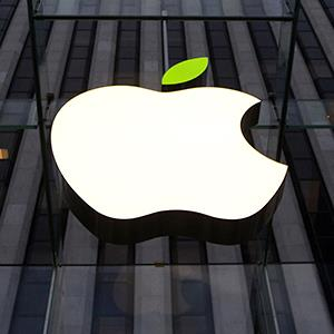 Credit: © Brendan McDermid/ReutersCaption: The leaf on the Apple symbol is tinted green for Earth Day at the Apple flagship store in New York April 22, 2014