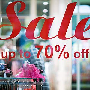 Sale sign in shop window © Michele Constantini/PhotoAlto Agency RF/Getty Images