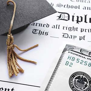 Diploma, mortarboard cap and cash © zimmytws/Getty Images