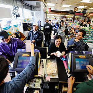 Customers wait in line to buy Mega Millions tickets at Bluebird liquor store on March 29, 2012 in Hawthorne, Calif. (© Kevork Djansezian/Getty Images)