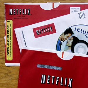 File photo of Netflix envelopes (© Paul Sakuma/AP)