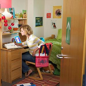 Student in dorm room © Digital Vision Ltd./SuperStock