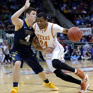 Texas' Martez Walker (24) drives against West Virginia's Chase Connor (4) during the quarterfinals of the Big 12 Tournament at the Sprint Center in Kansas City, Mo., on Thursday, March 13, 2014