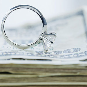 Wedding ring and cash © Jamie Grill, Photolibrary