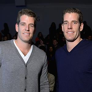 Tyler and Cameron Winklevoss during Mercedes-Benz Fashion Week on Feb. 8, 2013 in New York City (© Michael Loccisano/Getty Images for Mercedes-Benz Fashion Week)