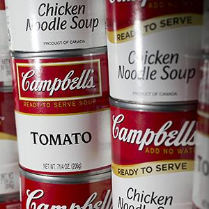 Credit: © Andrew Harrer/Bloomberg via Getty ImagesCaption: Cans of Campbell Soup brand products