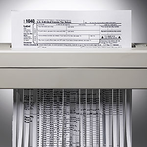 US tax form being shredded © Jeffrey Hamilton, Digital Vision, Getty Images