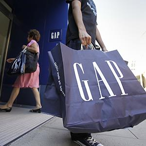 A shopper leaves a Gap store in Palo Alto, Calif. © Paul Sakuma/AP