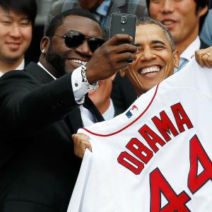 Boston Red Sox designated hitter David Ortiz (L) poses for a 'selfie' with U.S. President Barack Obama during a ceremony on the South Lawn of the White House to honor the 2013 World Series Champion Boston Red Sox April 1, 2014 in Washington, D.C. © Win McNamee/Getty Images