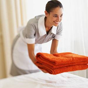 Hotel maid © Simon Jarratt/Corbis
