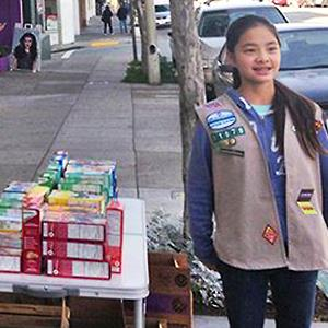 Danielle Lei sells Girl Scout cookies outside of a cannabis clinic. Courtesy of The Green Cross via Facebook, www.facebook.com/TheGreenCross