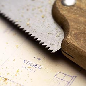 Saw and blueprints (© Vstock/age fotostock)