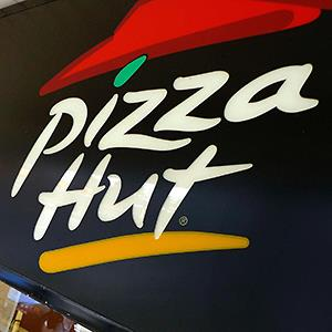 Credit: © Larry Downing/ReutersCaption: A Pizza Hut logo is pictured outside its restaurant