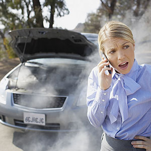 Calling for roadside assistance © Tom Merton/Photolibrary/Photolibrary