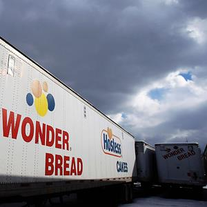 A Wonder Bread delivery truck trailer parked outside a bakery plant © Shannon Stapleton/Reuters, File