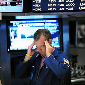 Caption: A trader works on the floor of the New York Stock ExchangeCredit: © Peter Foley/Corbis