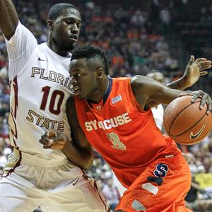 Jerami Grant #3 of the Syracuse Orange dribbles to the basket against Okaro White #10 of the Florida State Seminoles at the Donald L. Tucker Center on March 9, 2014 in Tallahassee, Fla. © Don Juan Moore/Getty Images