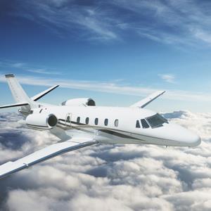 Private jet above clouds © franckreporter/Getty Images