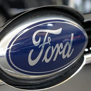 Ford logo on the grill of a Ford F-150 truck © Gene J. Puska/AP