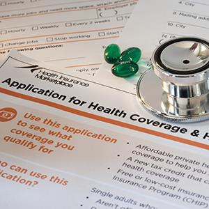 Healthcare application & stethoscope © Steve Hamblin/Fuse/Getty Images