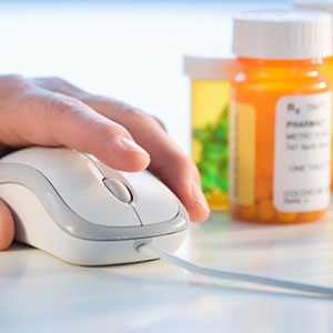 Pills with computer © Tom Grill, Getty Images
